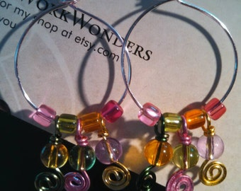 Multi-colored hammered wire wrapped glass beaded earrings..
