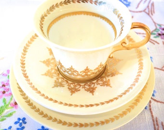 SALE SALE SALE 1930s hand painted aynsley china trio in creamy yellow, gold and white was 14.99 now 9.99