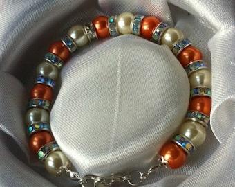 Ivory and orange bracelet