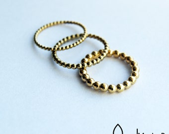 Beautifull ring  14karat  yellowgold - stack ring - made from globules in silver and gold