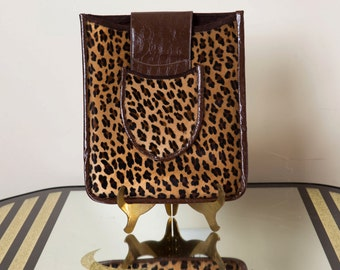 Elegant leopard iPad case with brown snakeskin accent closure and back