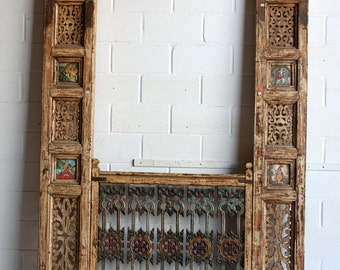 Yellow & beige patina frame with opening cast iron balcony rail. Intricate carving and indian god ceramic plates on sides. 264 cm tall
