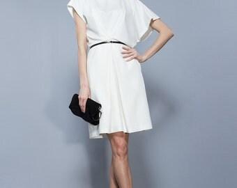 Loose Dress Ivory Knee Length Asymmetrical Sleeveless Dress.