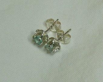 4mm round cut .60 ctw sky blue topaz sterling silver buttercup post stud earrings