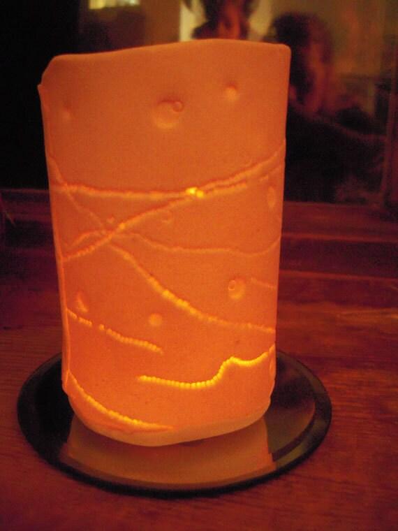 textured Ceramic translucent luminary or  vase.