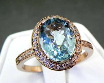 AAAA Aquamarine 2.33 Carats 10 X 8mm. in a 14k ROSE gold ring with diamonds (.32ct) Ring 1142