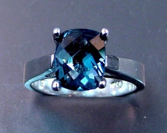 AAAA Natural London blue Topaz   10x8mm  3.02 Carats   in 14K white gold ring and available in yellow gold 0699