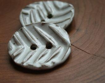 White herringbone buttons