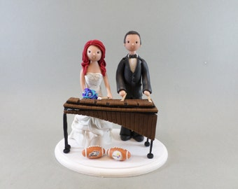 Bride & Groom with a Marimba Personalized Wedding Cake Topper