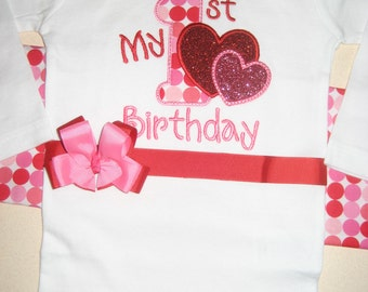 Valentine's Day First Birthday bodysuit with ribbon and bow