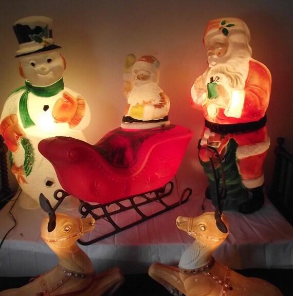 blown plastic christmas lawn figures