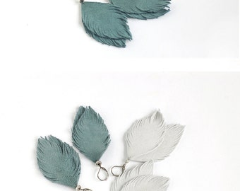 Suede leather feather earrings in smoky blue and in light grey. Set of two
