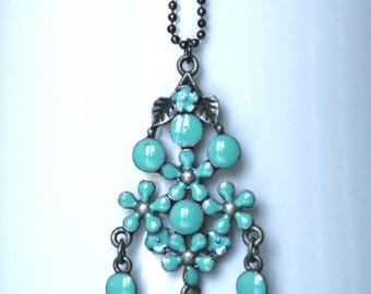 Beautiful necklace with floral turquoise enamel pendant on gunmetal ball chain.