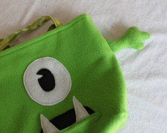 Green one-eyed monster bag