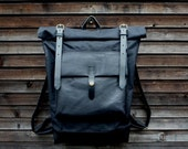 Black waxed canvas rucksack/backpack with roll up top and oiled leather bottem COLLECTION UNISEX