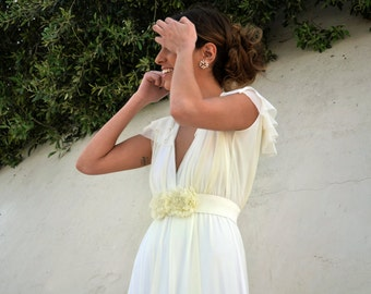 Romantic wedding dress with a floral belt