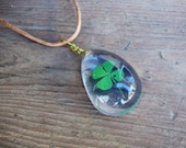 Real four leaf clover encased in clear resin on adjustable leather cord St.Patricks day