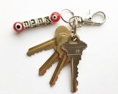 Love in Hebrew Ahava Silver and Red Evil Eye Key Ring
