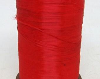 Large spool red acetate fiber