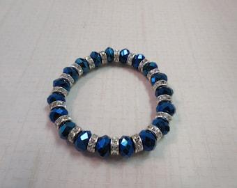 Beautiful 8mm Blue Crystal beads and rhinestone crystal spacers bracelet.