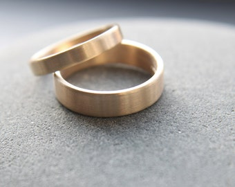 3mm + 5mm flat wedding ring set for him and her in 9ct yellow gold, brushed finish - made to order from recycled gold