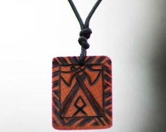 Othala Rune pendant with crossed axes.