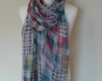 A colourful check chiffon scarf.