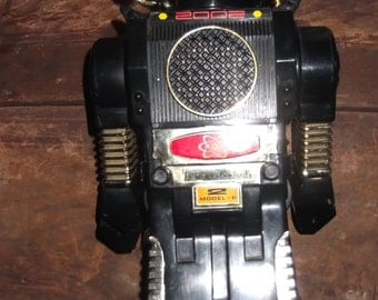 Vintage Robot, works walks, eyes light up with claw hands, cute, hard plastic electronic robot