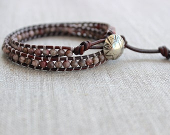 Leather and jasper wrap bracelet. Leather wrap bracelet with semi precious gemstones, white bronze button. Pink ocean jasper wrap bracelet.