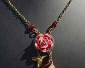 Upcycled vintage thimble hummingbird rose necklace
