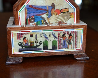 Ancient Egyptian coasters set in a mother of pearl box.