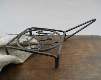 Vintage metal pot holder Black metal trivet with a handle Farmhouse kitchen