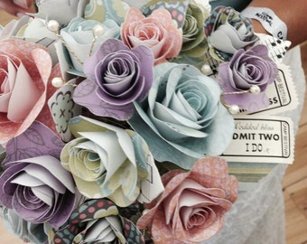 Paper flower bouquet with personalised ticket detail pastel shades of summer paper bridal posy
