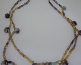 Double strands flourite, rutilated quartz,  moss amethyst brios caught by a golden leaf clasp makes Random Beauty Necklace