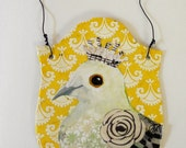 Bird Bust on a hanging collage mount