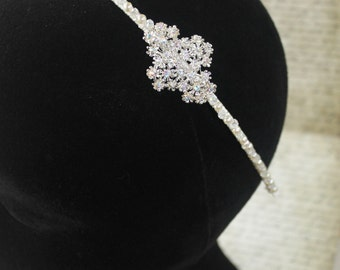 Isabelle: A Diamante Flower Cluster Side headband, with Clear Crystals and Ivory Pearls.