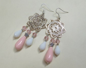 Unique elegant chandelier earrings with pendants made of pink coral smooth drops, multifaceted white crystal drops and silvertoned star/disk