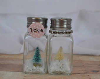 Handmade OOAK Salt and pepper shaker set of miniature vintage bottle brush trees white and green;faux snow LOVE button/ribbon; rhinestones