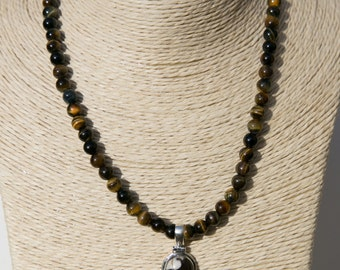 """Tiger's eye beaded necklace with pendant which includes peanut jasper, tiger's eye and citrine. Bali silver toggle clasp. 16 1/2 """" long"""