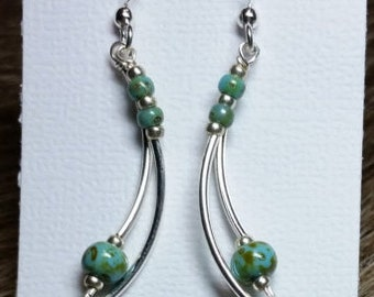 Interestingly Curved Silver Dangles Have Caribbean Blues Czech Beads At The Top And Bottom