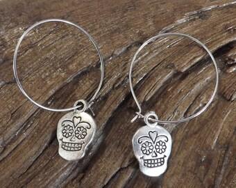 Ladies tibetan silver candy skulls charm on hoop earrings