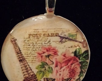 Handmade glass pendant necklace with  picture of roses and the Eiffel Tower