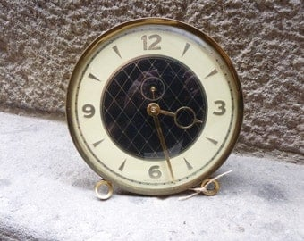 Antique wind-up gold alarm clock, West Germay from the 50-60's