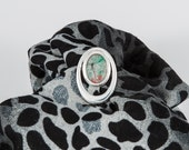 Silver plated oval scarf clip with pretty green, gold and red resin centre