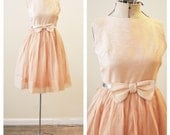 Vintage 1960's Orange Peach silver metallic party dress for child, teen girl, or xxs adult with bow