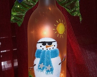 Welcome to the Beach House! Lighted, painted wine bottle with Snowman/Palm Tree