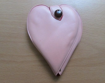 Vintage travel manicure set in pink heart-shaped vinyl pouch, made in Sheffield