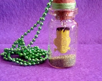 Necklace with glass flask with Frankenstein's face