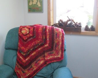 wool blanket, red, orange, yellow, crocheted hexagon