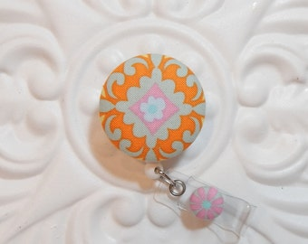 Retractable Badge Holder Id Reel  Fabric Covered Button  Orange And Blue